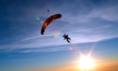 Skydiver enjoying a canopy ride on a sunny day