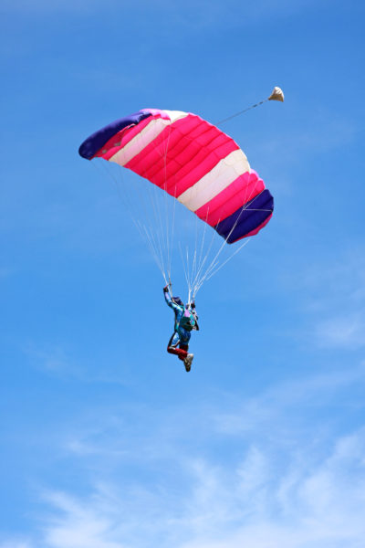 Skydiver enjoying the view from his parachute ride
