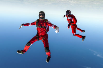 Two professional skydivers upside down during free fall