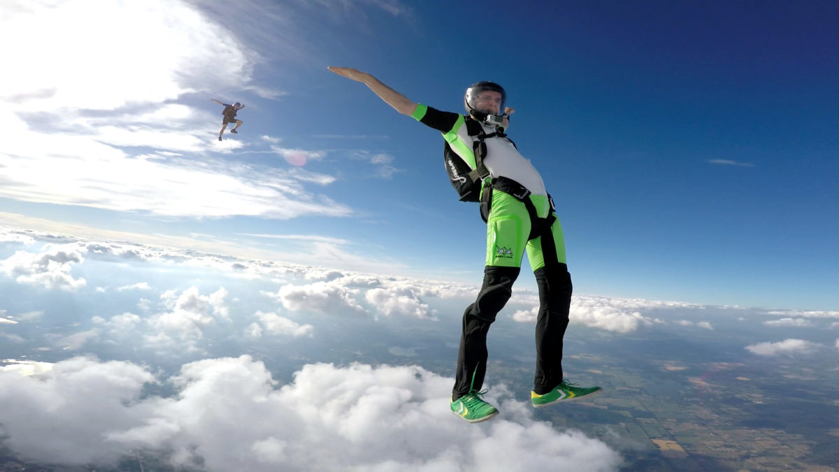 Experienced skydiver spreading arms and legs during free fall