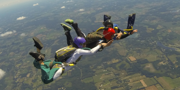 skydivers holding each others arms