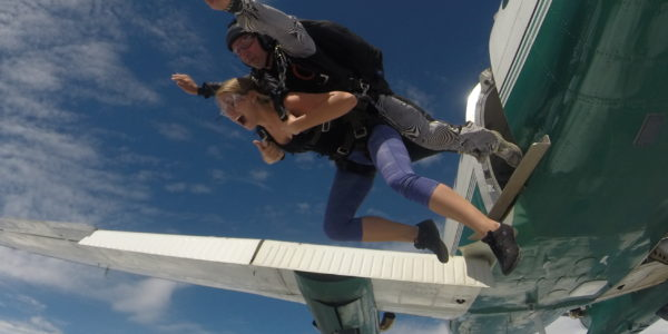 Tandem student and instructor jump from a plane