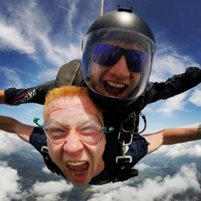 Tandem skydiving student yells out of joy during free fall