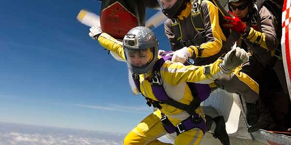 Experienced skydivers jumping out of a plane, one by one