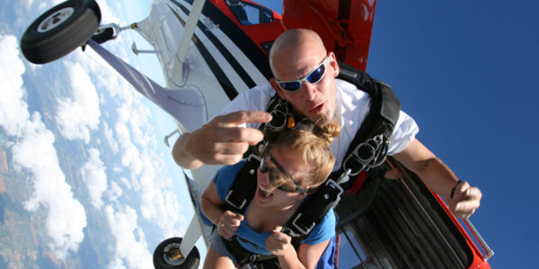 Tandem skydivers jump out of a plane with Skydive Tecumseh