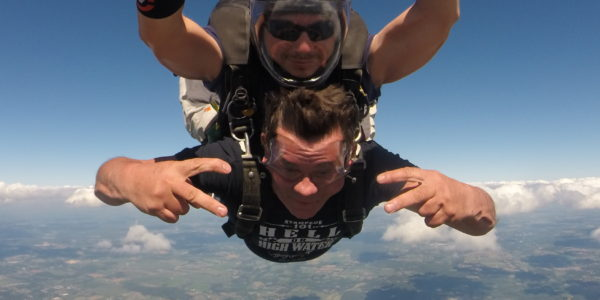 Tandem skydiving student looking stoked