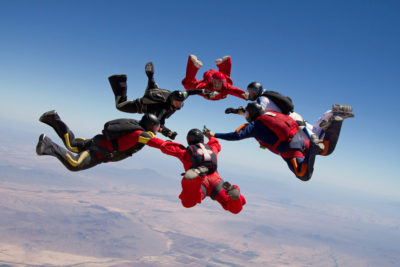 Skydivers making a formation in the sky