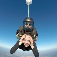 Tandem skydiving student looking worried