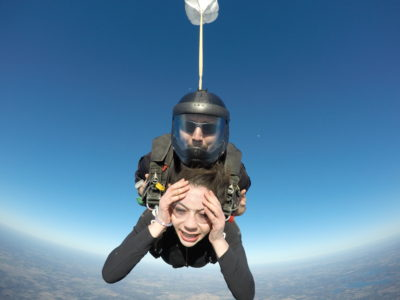 Tandem skydiving student with a worried look on her face