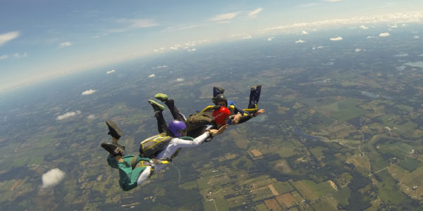Skydivers holding hands during free fall