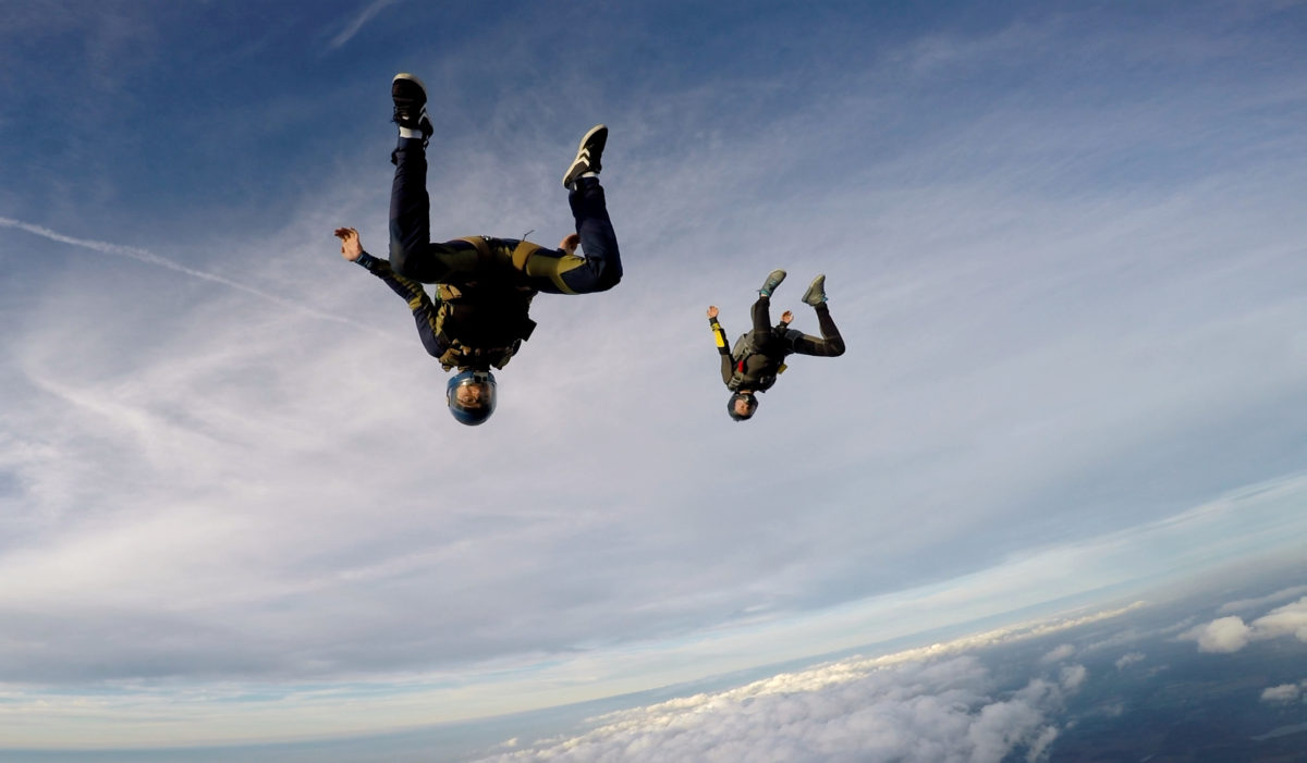 Skydivers angle flying