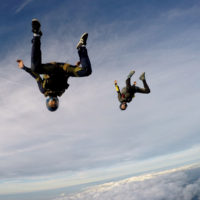 Pro skydivers free falling upside down