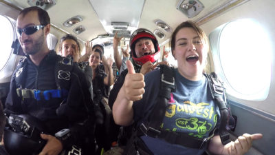 Skydivers getting ready in the plane