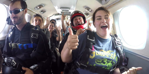 Skydivers in the plane before their jump