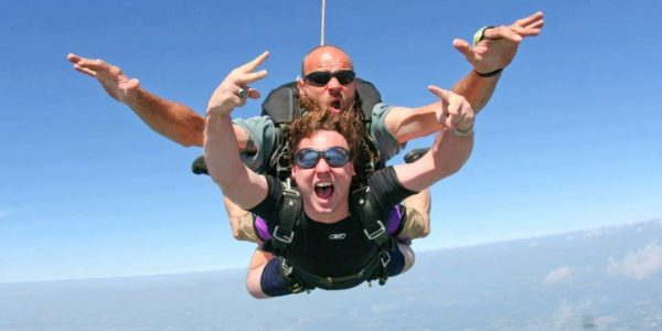 Tandem student and instructor in mid free fall