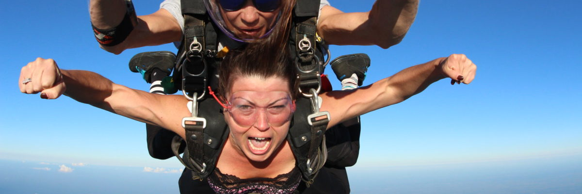 A tandem student shouts while in free fall